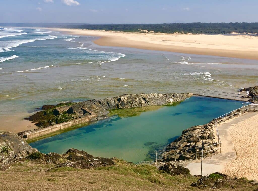 A view from Bonville Headland at Sawtell, looking over the Sawtell rock pool, to the Bongil Bongil National Park and beaches, NSW